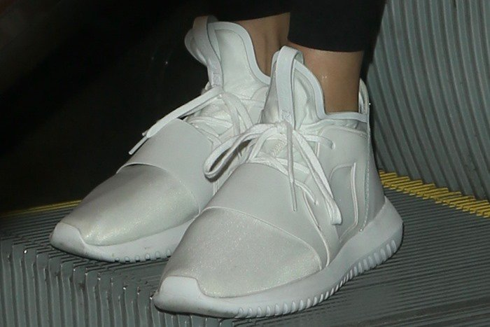 Kendall Jenner wearing white adidas Tubular Defiant premium tech sneakers
