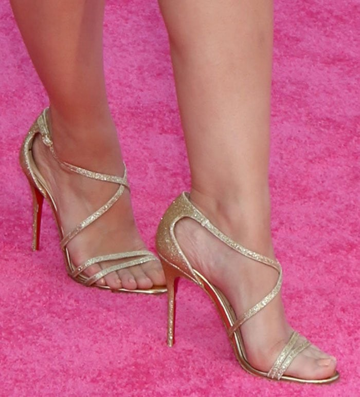 Kristen Bell displays her pretty toes in shimmery gold heels