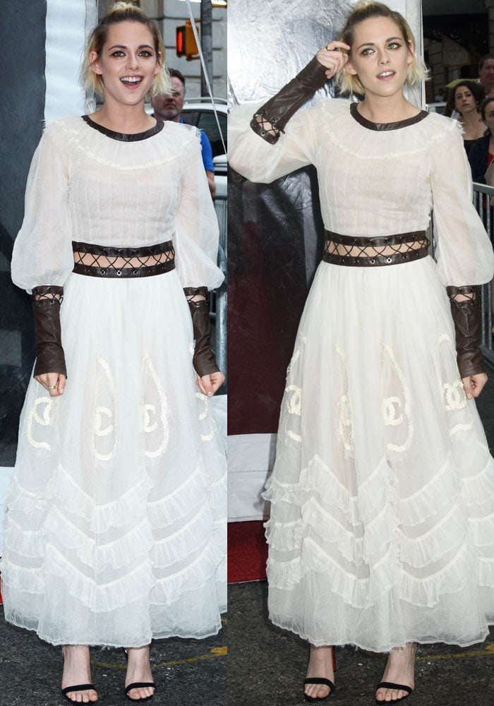 Kristen Stewartin a quirky dress from the Chanel Fall 2016 collection featuring extended leather cuffs, neckline and waist cutouts adorned with eyelets