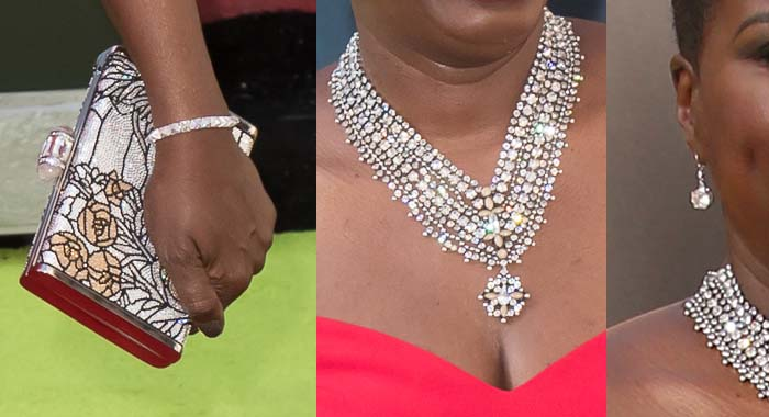 Leslie Jones added bling with a Danni Jo necklace, Chris Aire earrings, and metallic Judith Leiber clutch