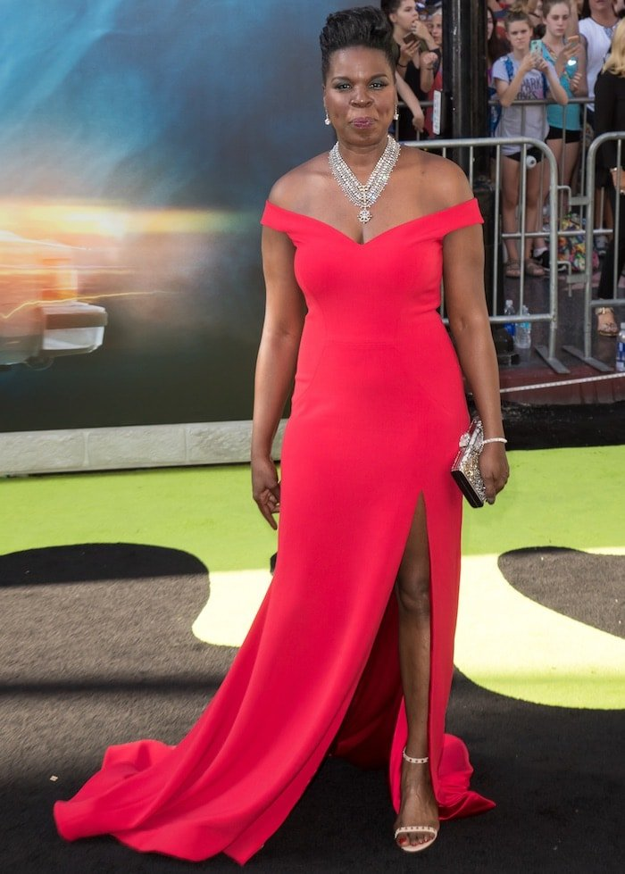 Leslie Jones rocks an off-the-shoulder red gown with a thigh-high slit