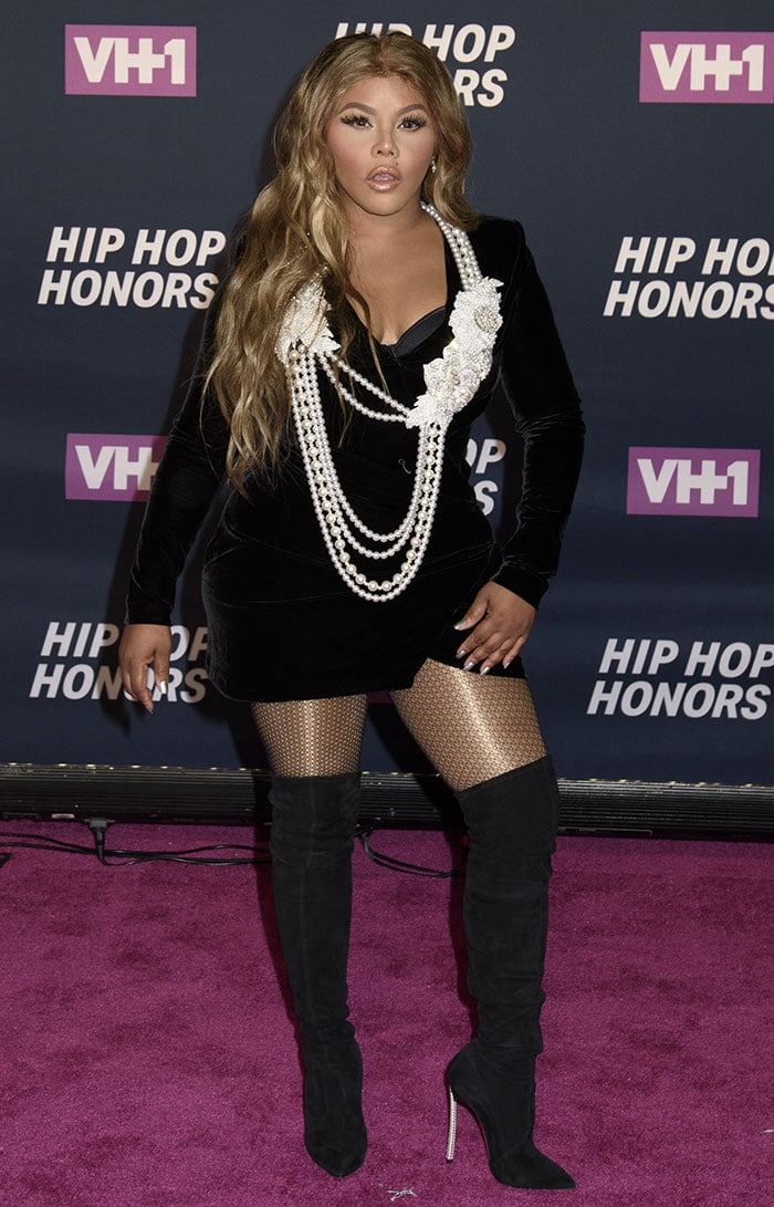 Lil Kim in a black velvet dress at the VH1 Hip Hop Honors: All Hail the Queens held at the David Geffen Hall in New York City on July 11, 2016