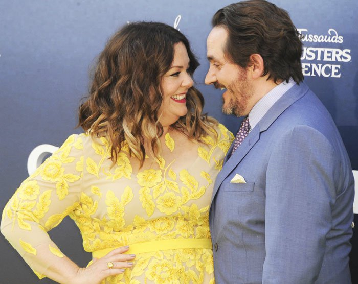 Melissa McCarthy and her comedian husband Ben Falcone share a moment on the red carpet
