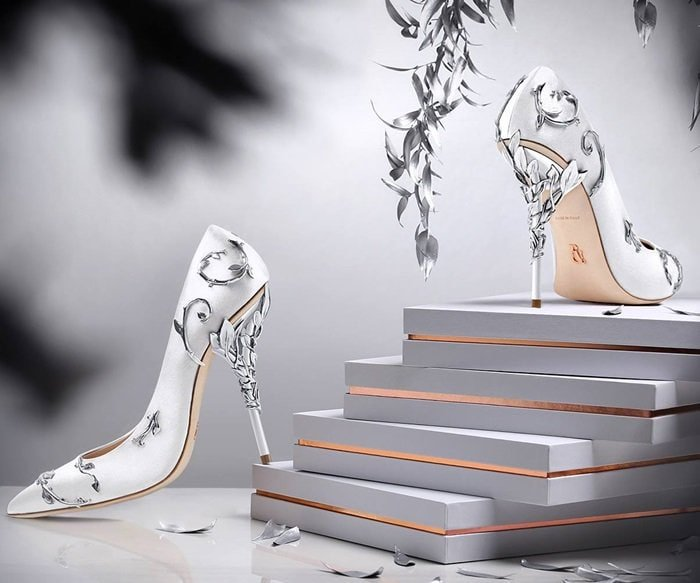 With ornamental filigree leaves spiraling naturally up the heel, this stunning pump harks back to the beauty and perfection of a lost paradise