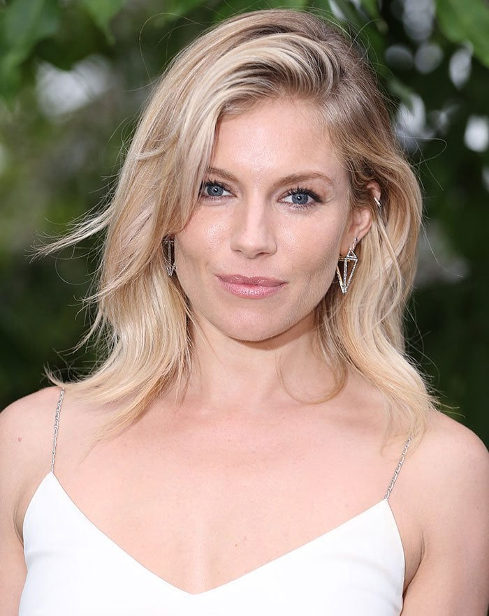 Sienna Miller's 3D drop earrings and side-swept tousled tresses