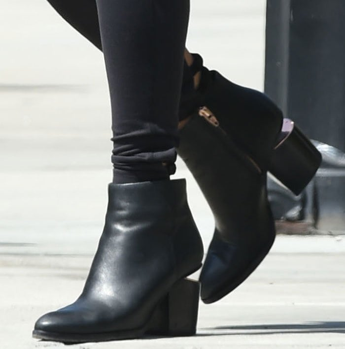 Vanessa Hudgens' leather ankle boots feature tapered toes and concealed side-zip closures