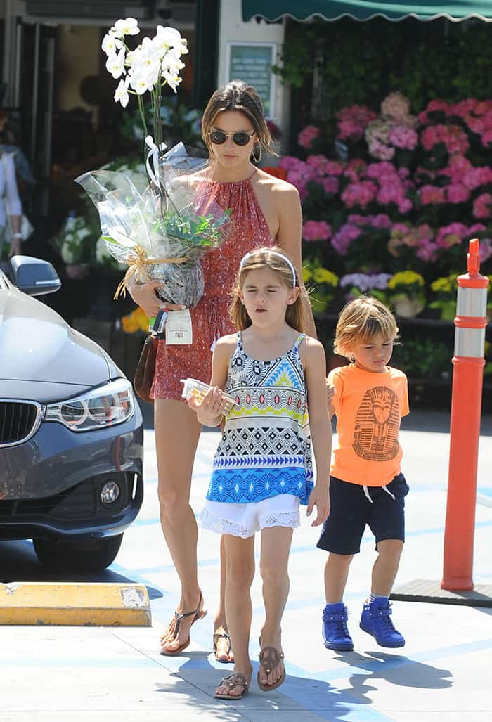 Alessandra Ambrosio shows off her endless legs ina red, printed romper from Faithfull The Brand