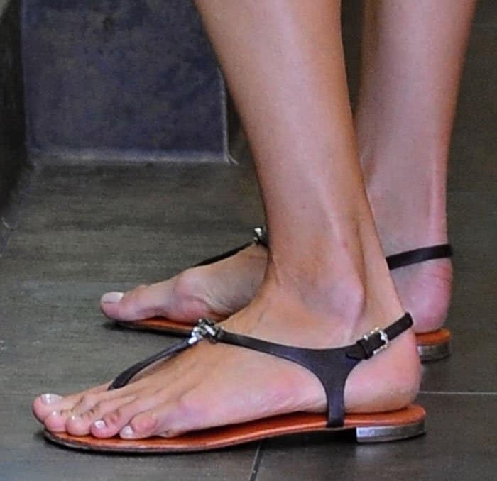 5425fd08570e Alessandra Ambrosio Parades Endless Legs in Flat Thong Sandals