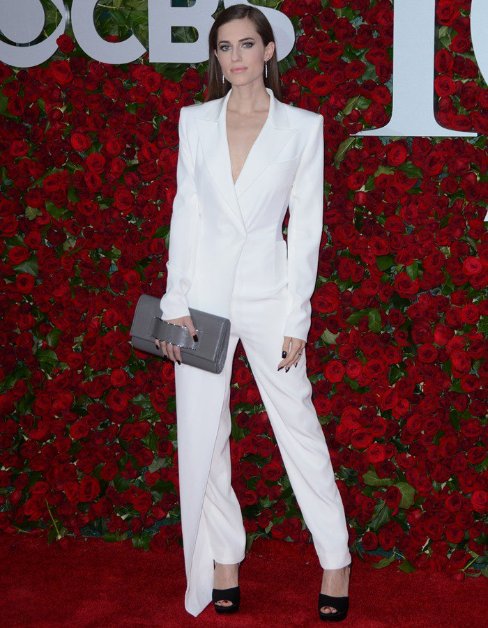 Allison Williams wearing a white DKNY tuxedo-inspired jumpsuit at the 2016 Tony Awards held at the Beacon Theatre in New York City on June 12, 2016