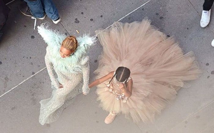 Beyoncé and daughter turn heads in their coordinated outfits as they make their way through the crowd