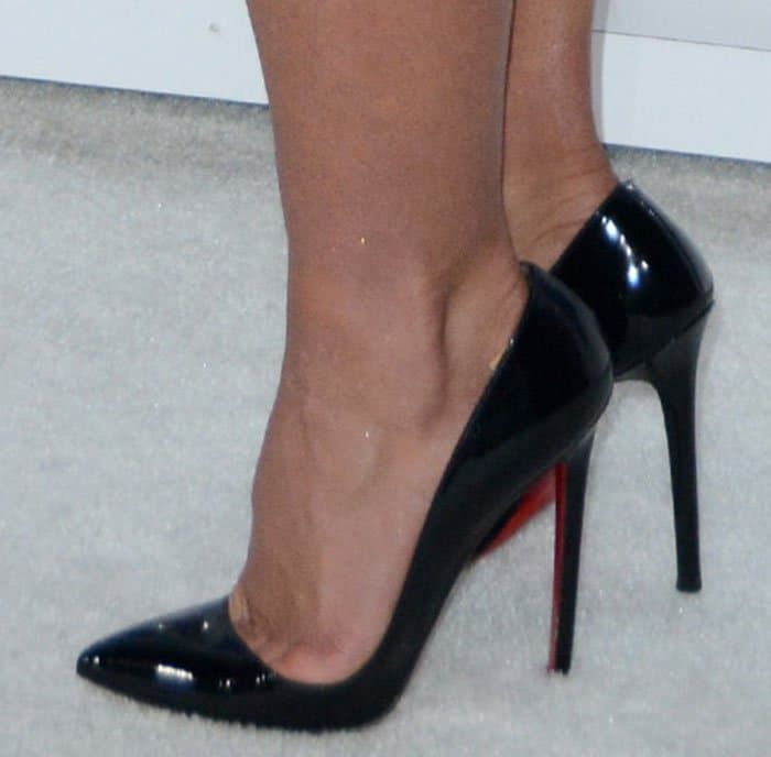 Britney Spearssqueezed her feet into black Christian Louboutin pumps