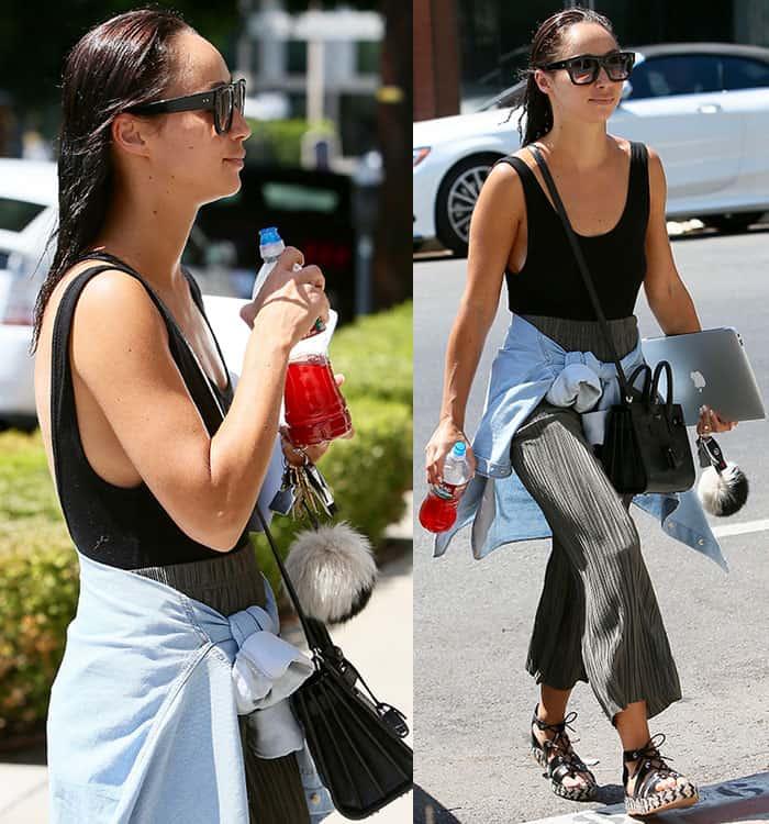 Cara-Santana-black-bodysuit-loose-pants