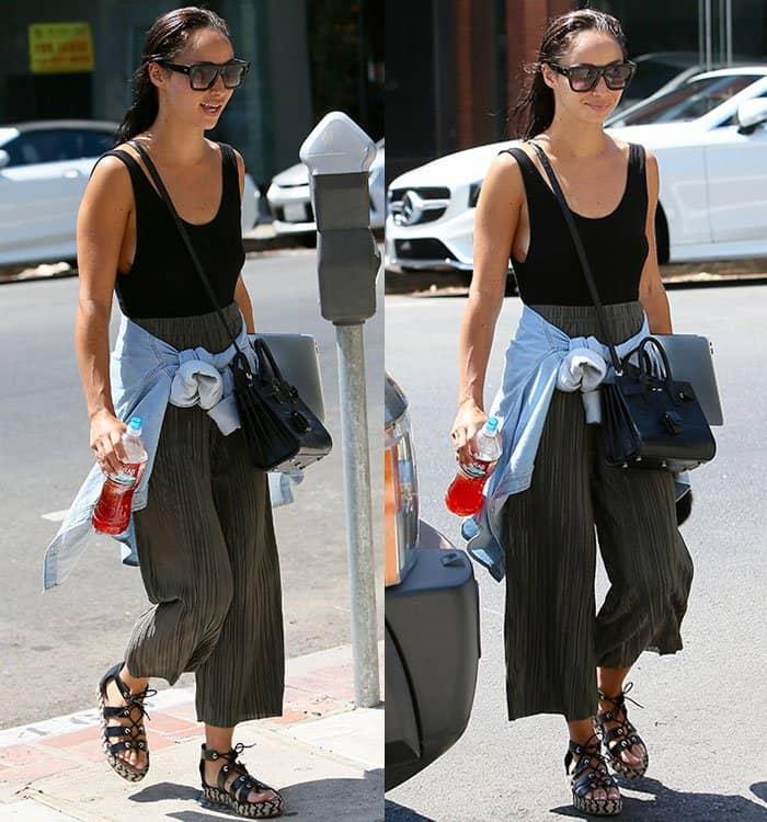 Cara-Santana-black-top-loose-pants-lace-up-sandals