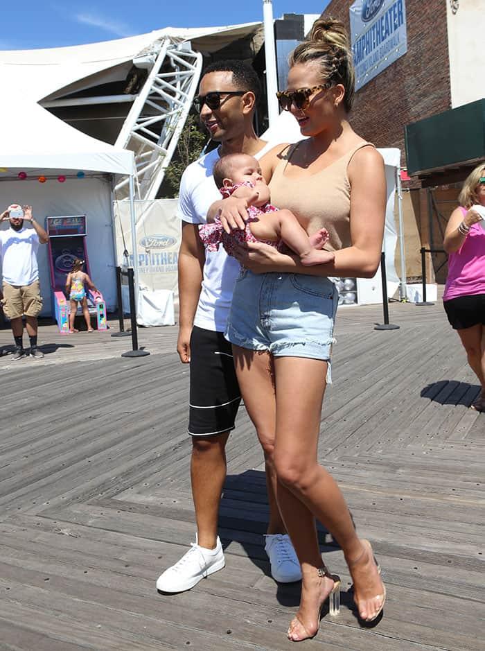 Chrissy Teigen brought along her husband John Legend and her four-month-old daughter, Luna