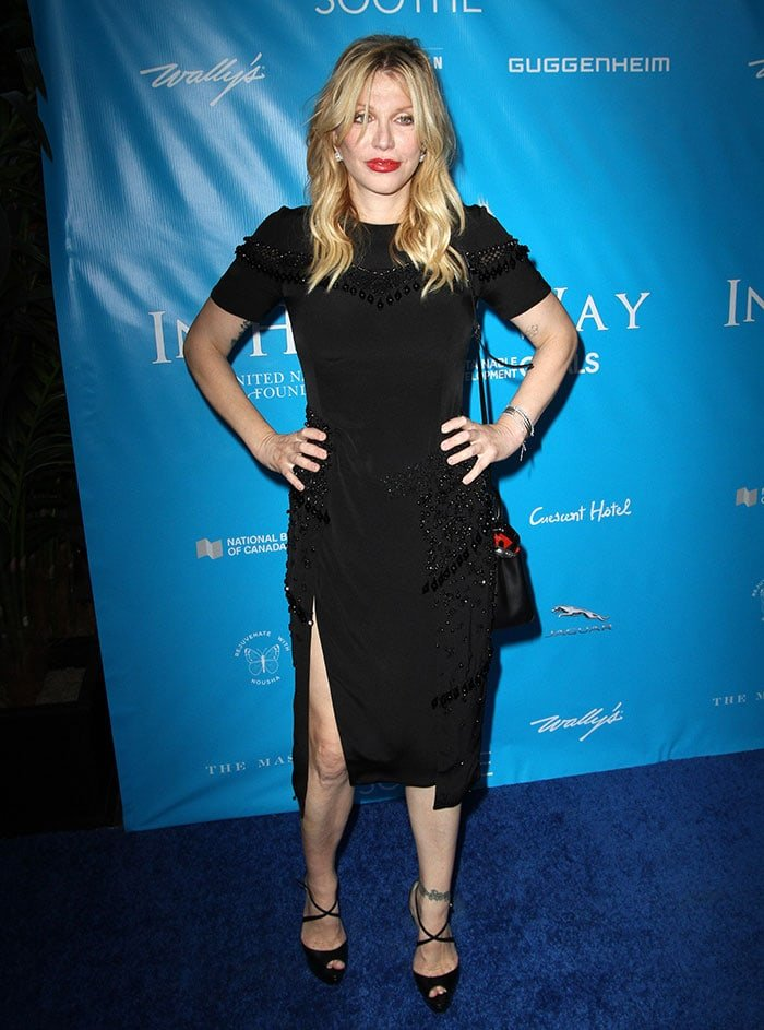 Courtney Love shows off her sexy legs ina classy black dress