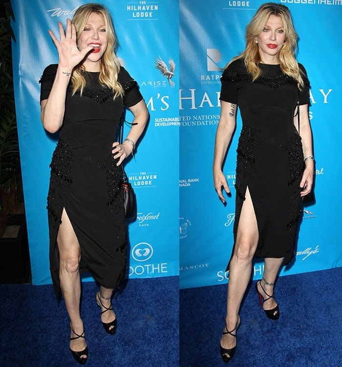 Courtney Love in a black embellished dress that showcased her legs