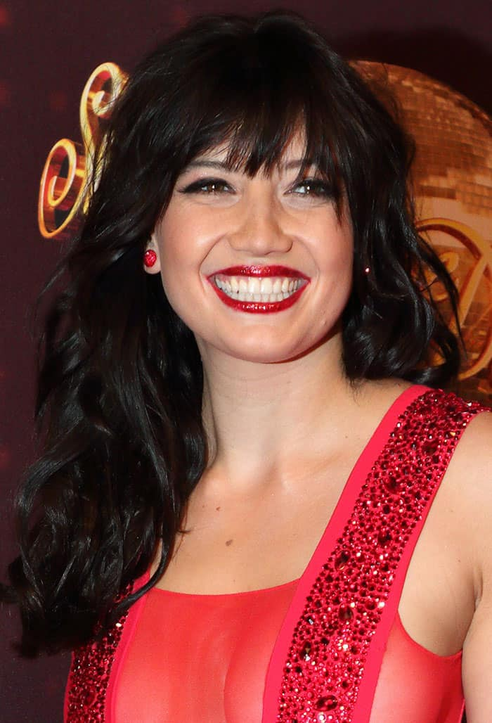 Daisy-Lowe-shimmering-red-lipstick