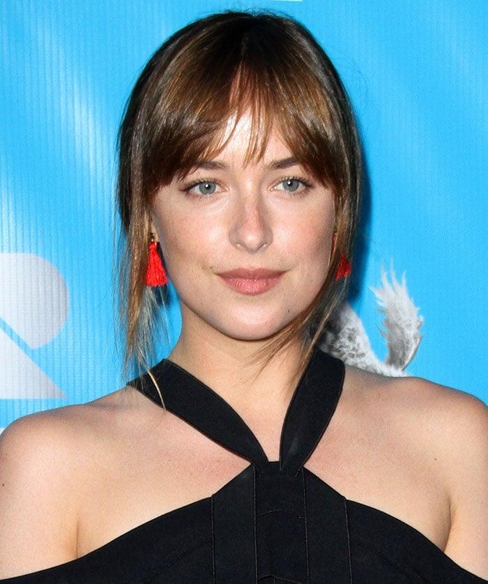 Dakota-Johnson-messy-updo-natural-makeup-red-tassel-earrings