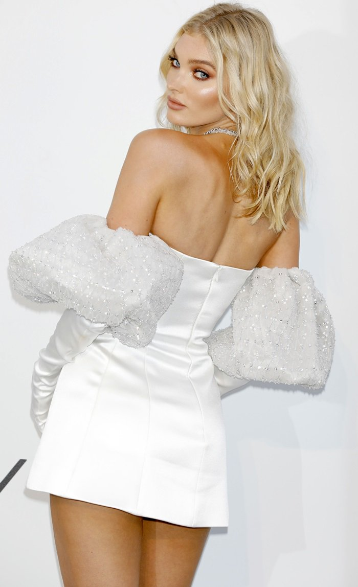 Elsa Hosk in a silky white Redemption mini dress with matching gloves