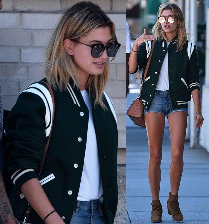 Hailey-Baldwin-long-legs-denim-shorts-green-varsity-jacket