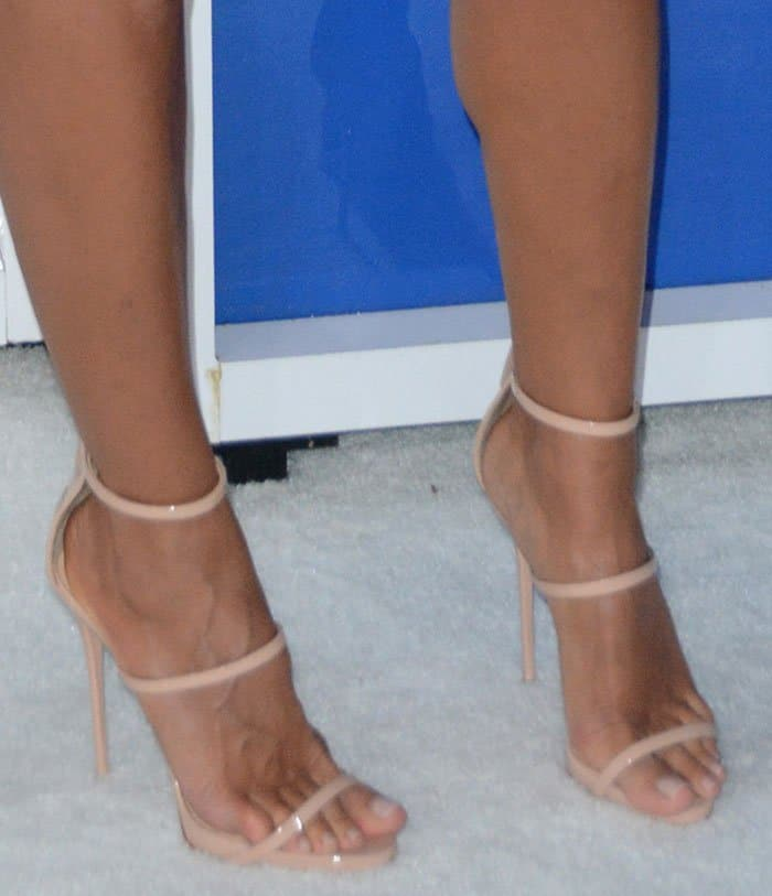 Heidi Klum drew attention to her insured legs instrappy heels by Giuseppe Zanotti