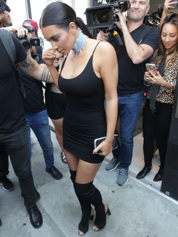 Kim Kardashian styled the tight black dress with a distressed denim choker by Sorella and a pair of custom black Yeezy boots