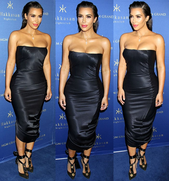 Kim Kardashian'scross pendant necklace drew attention to her ample cleavage