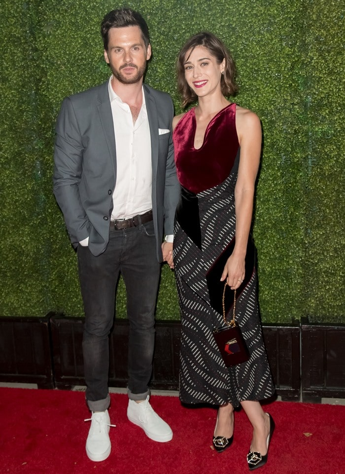 Lizzy Caplan posing with her fiancé, 35-year-old English actor and producer Tom Riley