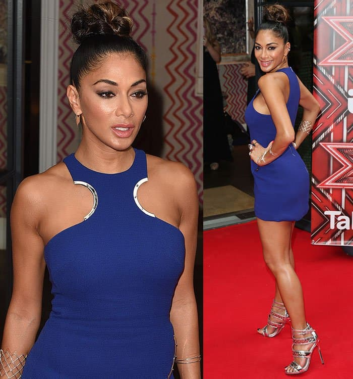 Nicole Scherzinger showcases her toned shoulders in a sexy dress with halterneck cutout detail