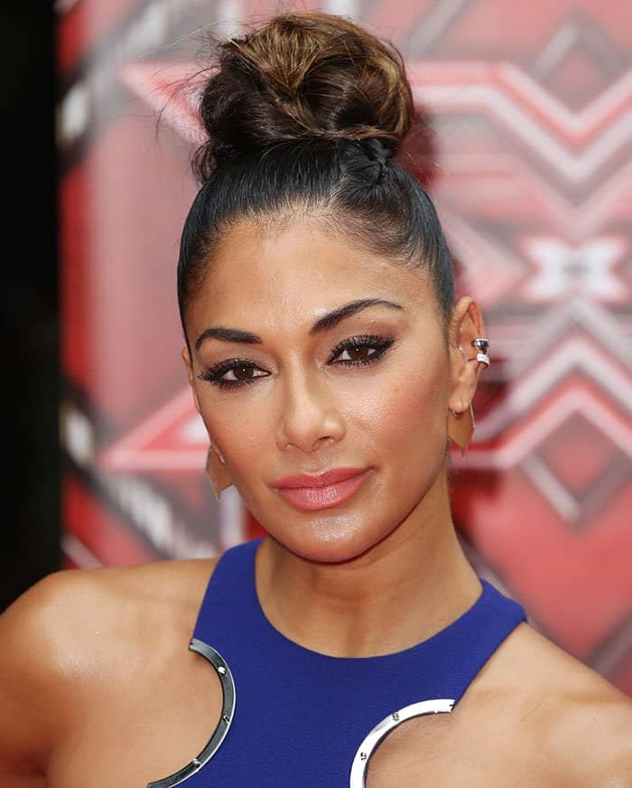 Nicole Scherzinger pulled her tresses up into a top knot