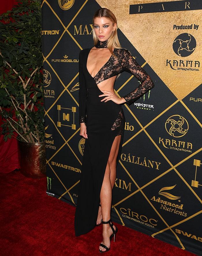 Stella-Maxwell-racy-black-lace-cutout-dress
