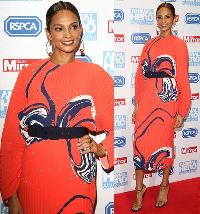 Alesha Dixon in a bright orange '70s-inspired ribbed dress