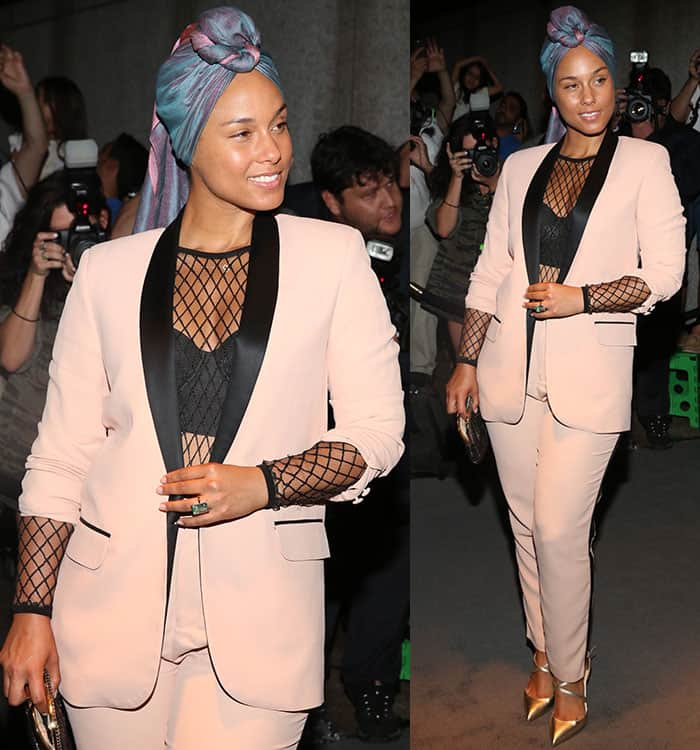 Alicia Keysflashed a hint of cleavage and abs in Tom Ford blush suit