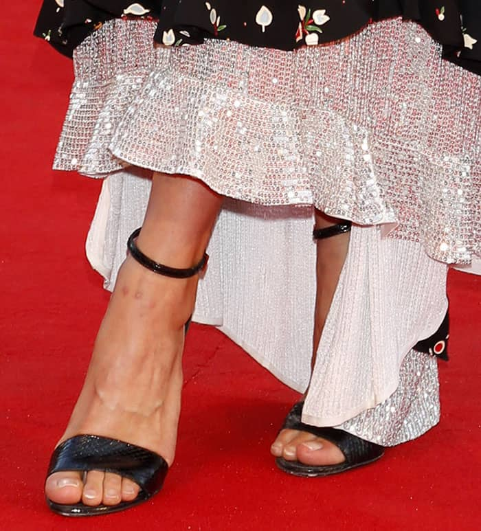 Alicia Vikander shows off her hot feet in Louis Vuitton sandals