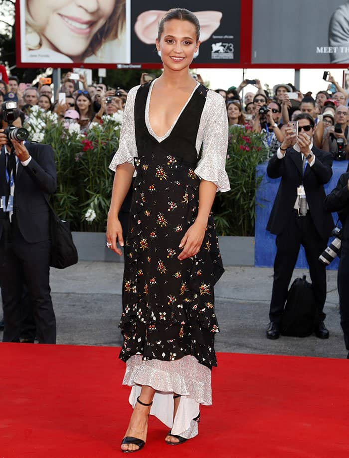 Alicia Vikander accessorized the look with just a statement ring and a pair of black sandals