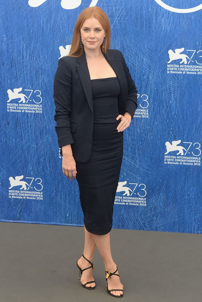 Amy Adams in a figure-hugging Tom Ford black dress and a blazer