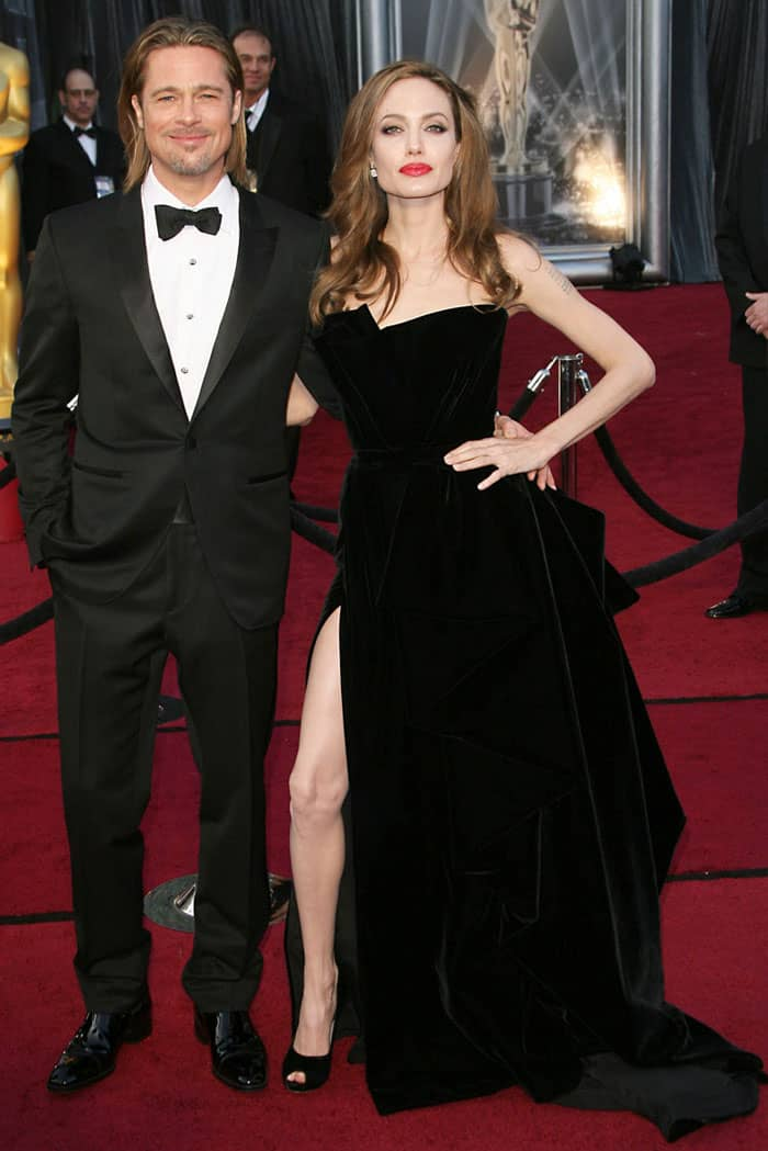 Going viral in a leg-baring black Atelier Versace velvet gown and black Salvatore Ferragamo velvet pumps