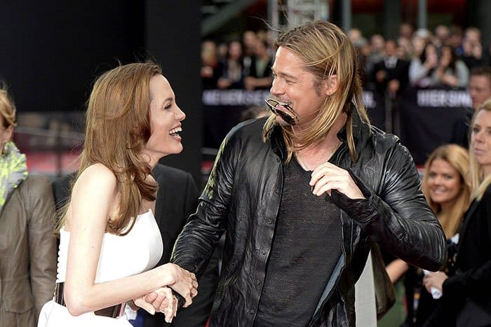 """Angelina Jolie and Brad Pitt laughing it up at the """"World War Z"""" premiere at Cinestar movie theatre at Potsdamer Platz Square in Berlin, Germany, on June 4, 2013"""