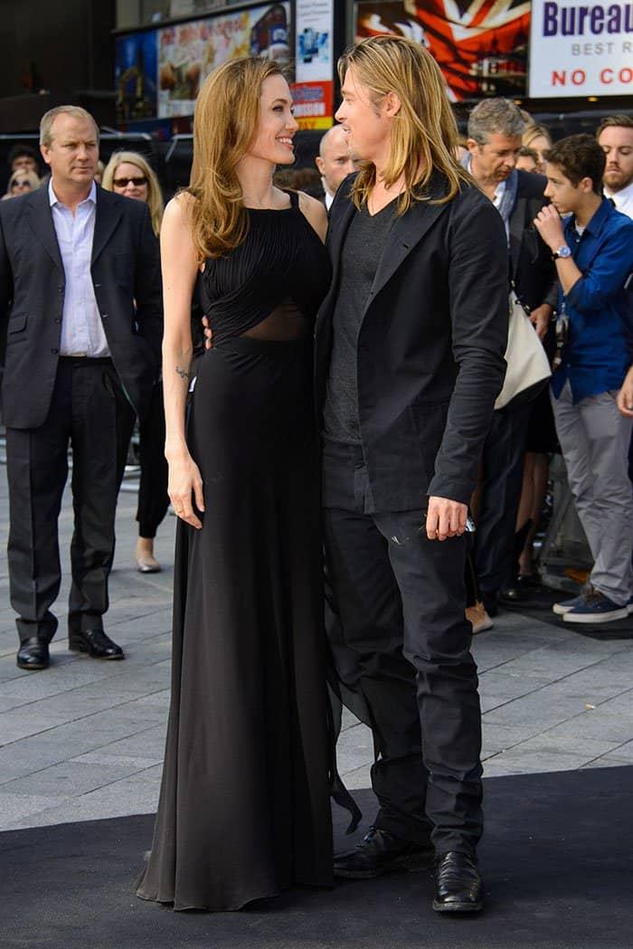Coupling up in a black Saint Laurent gathered gown and black Saint Laurent Janis platform pumps