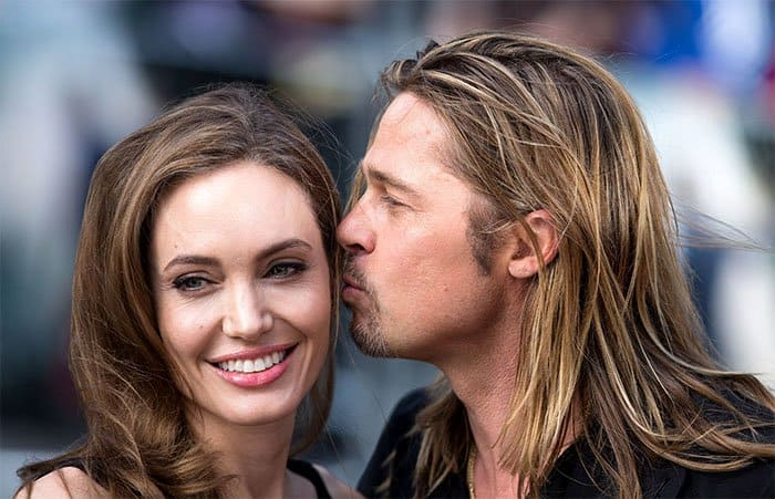 Brad Pitt giving Angelina Jolie a kiss at the premiere of World War Z at Empire Leicester Square in London, England, on June 2, 2013