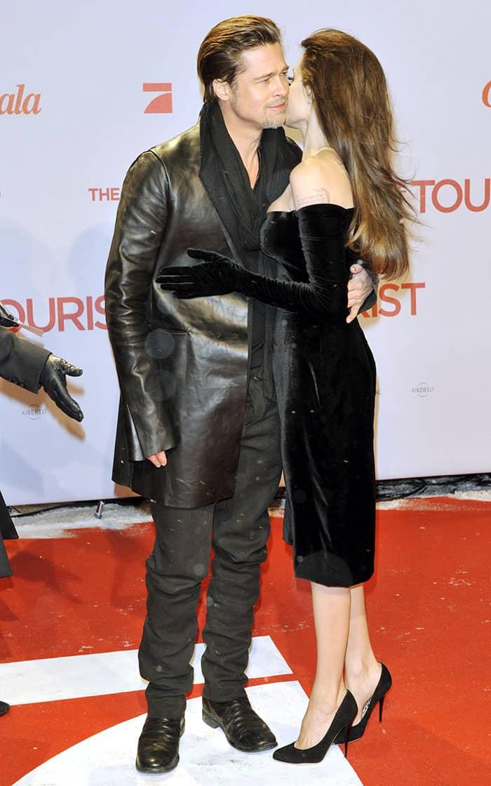 Alluring in a black Versace velvet dress with built-in gloves and black Salvatore Ferragamo pumps