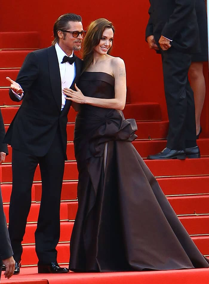 Regal in a chocolate Atelier Versace strapless silk gown and matching Salvatore Ferragamo satin peep-toes
