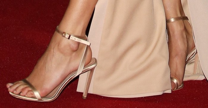 Bella Hadid shows off her hot feet in gold shoes