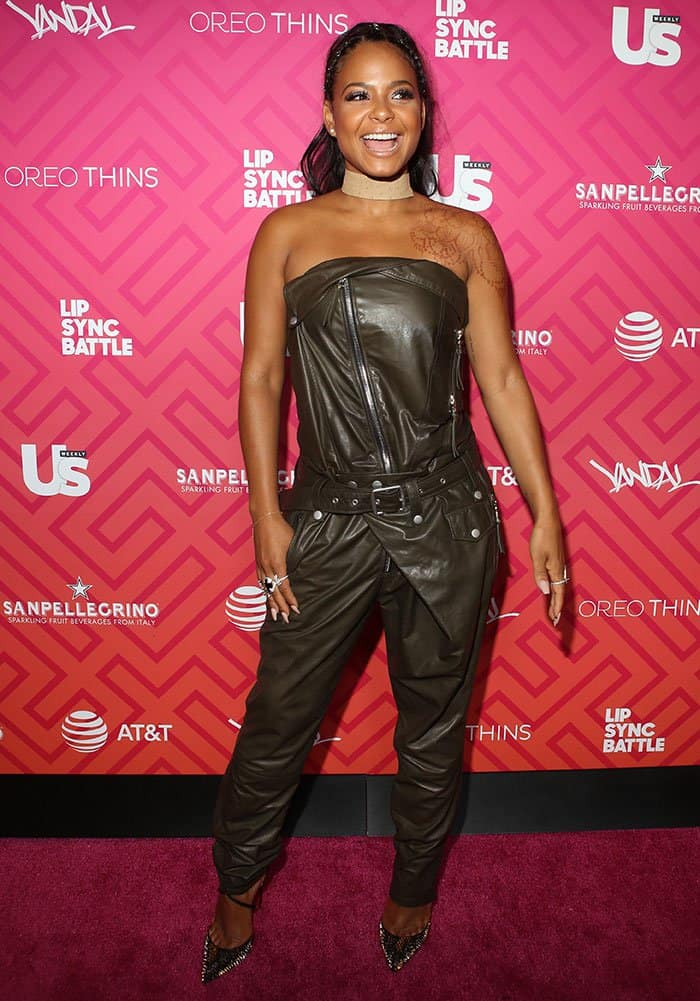 christina-milian-zipped-studded-olive-green-leather-jumpsuit