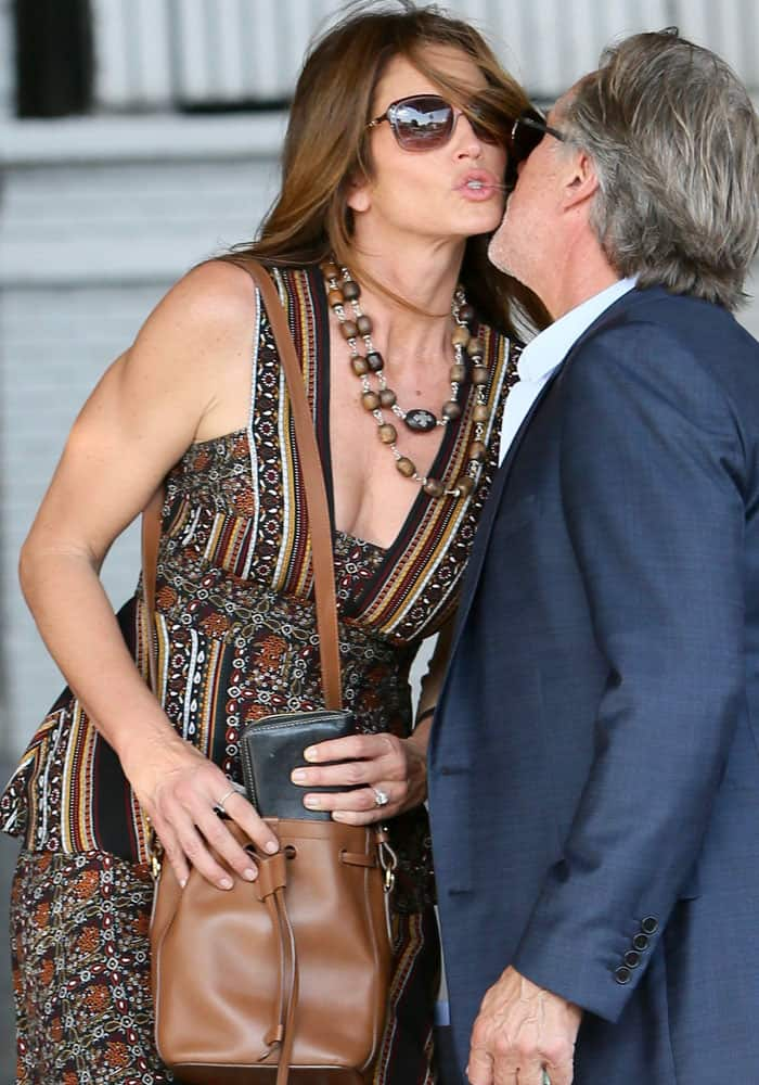 Cindy gives a goodbye kiss as she leaves the Revlon philanthropic luncheon