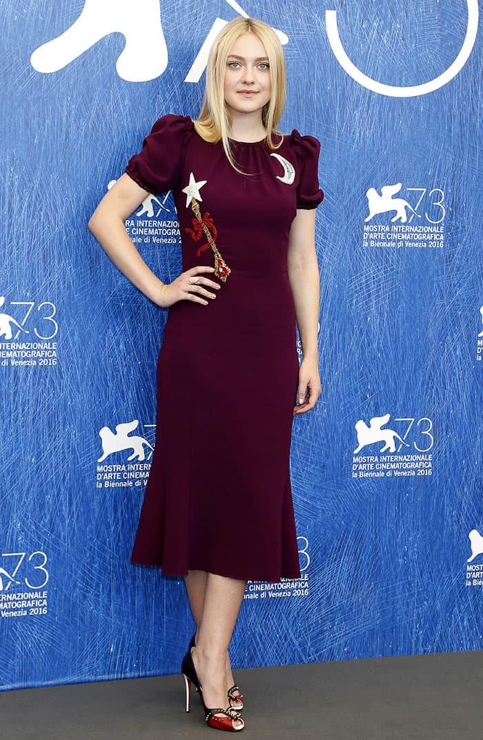 Dakota Fanning flaunted her toned figure ina purple dress from Dolce & Gabbana