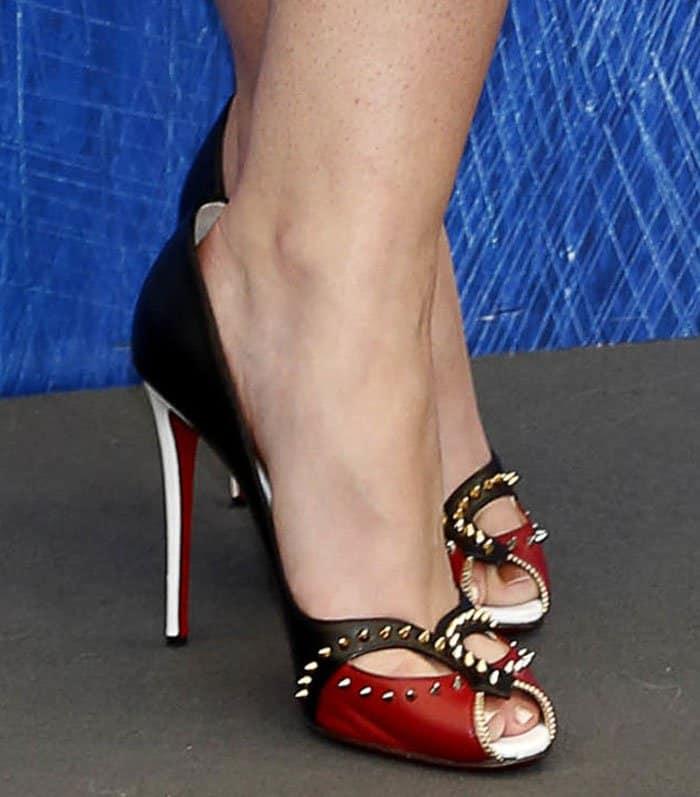 Dakota Fanning shows off her feet in Christian Louboutin pumps