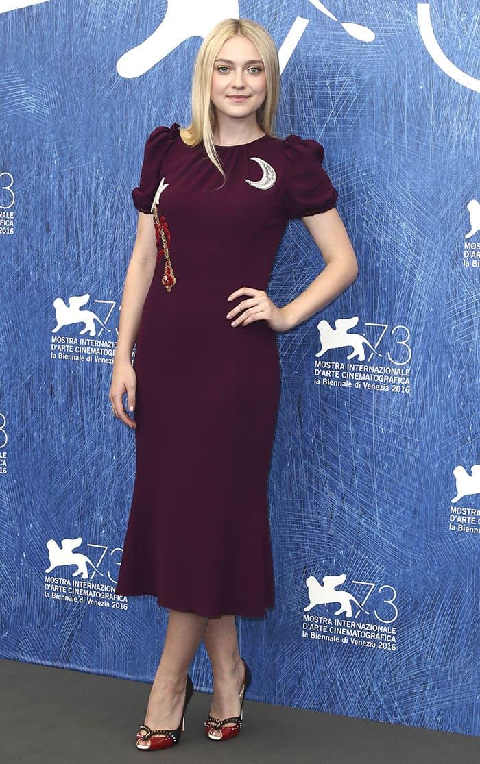 Dakota Fanning flaunts her sexy legs in a Dolce & Gabbana dress