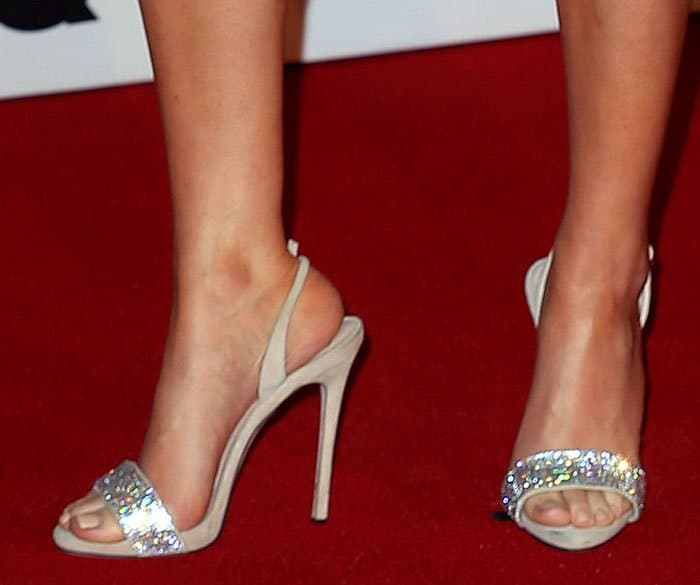 Ellie Goulding in Giuseppe Zanotti sandals featuring crystal-embellished toe straps
