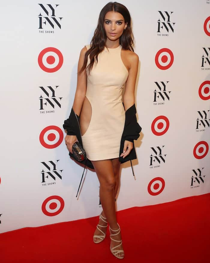 Emily Ratajkowski in an August Getty Atelier cutout dress paired with nude cage sandals for the IMG + Target New York Fashion Week Kickoff event at The Park at Moynihan Station on September 6, 2016.